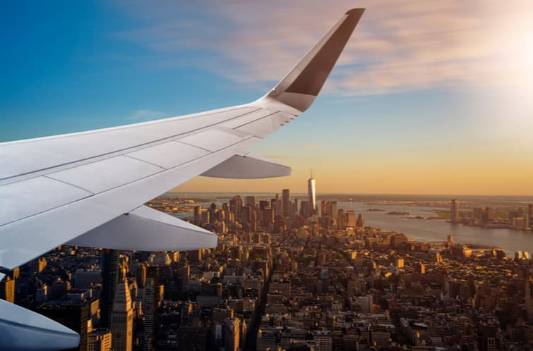 airplane flying over new york city