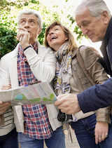 a group of seniors consult a map as they explore NYC